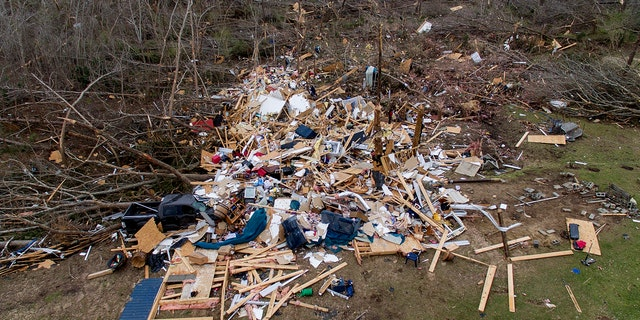 Debris litters a yard the day after a deadly tornado damaged a home in Beauregard, Ala., Monday, March 4, 2019.