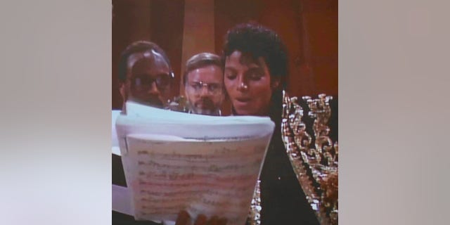 Quincy Jones, Thomas Bahler and Michael Jackson working together in 1985