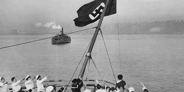 Flagship ceremony on Bremen in the port of New York. After the Reichsflaggengesetz adopted by the Reichstag, the German merchant flag was replaced by the Nazi flag. Photo by ullsteinbildvia Getty Images)