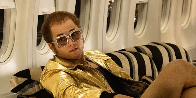 "Taron Egerton plays Elton John in the biographical film ""Rocketman"" premiering on May 31."