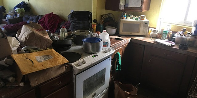 """Excessive animal fecal and urine matter"" throughout the entire home, in addition to floors and countertops piled with trash."