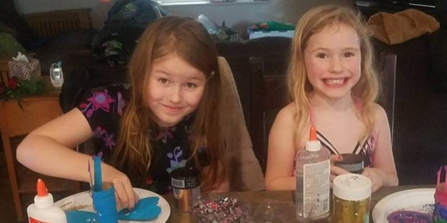 Leia (left) and Caroline are seen in this undated photo. The Humboldt County Sheriff's Office said the two girls are believed to have walked off into the wooded area nearby their home.