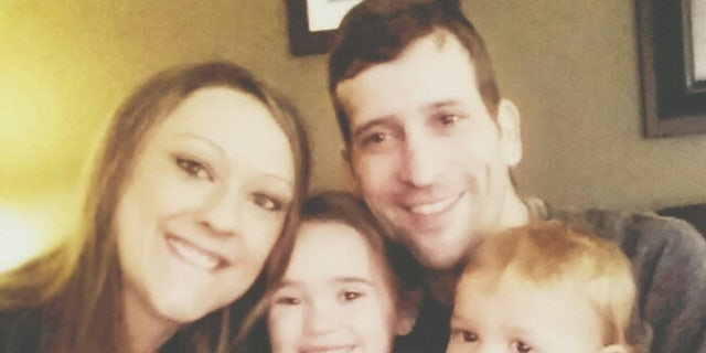 The couple, pictured with their two children, said they told the kids that they were both sick, but avoided using the word cancer.