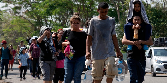 Central American migrants on a road in Tapachula, Chiapas State, Mexico, Thursday. (AP Photo/Isabel Mateos)