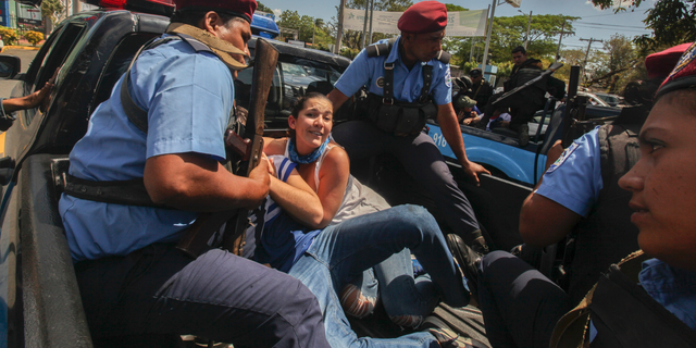 FILE - In this March 16, 2019 file photo, police detain protesters in Managua, Nicaragua. Nicaraguan government negotiators have signed an agreement on Friday, March 29, ratifying their commitment to free hundreds of people considered political prisoners by the opposition. (AP Photo/Alfredo Zuniga, File )