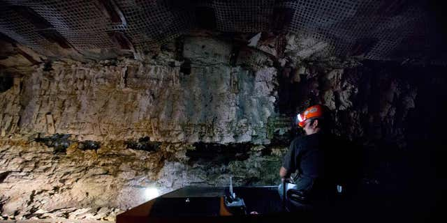 A worker drives a train wagon as he makes a tour of the Portal 31 coal mine which has become a tourist attraction in Lynch, Kentucky. (AP Photo / David Goldman)