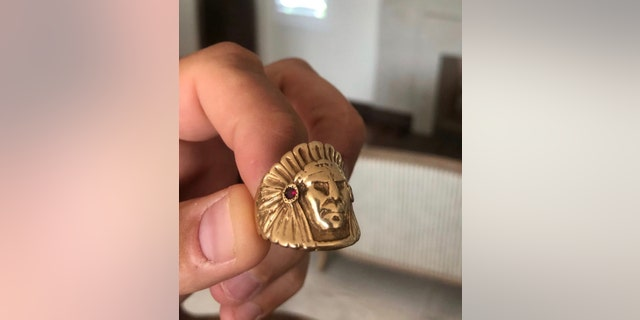 Brady Cobb said this ring, a 24-carat, ruby-adorned Indian head, was given to his father for moving more than a million pounds of marijuana for Pablo Escobar.