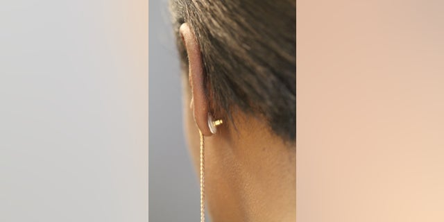 An example of the contraceptive earring being worn.