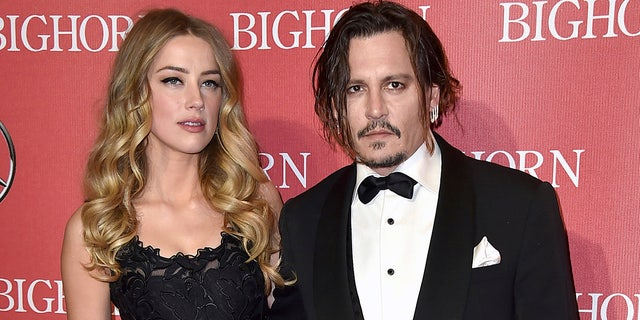 In this Jan. 2, 2016, file photo, Amber Heard, left, and Johnny Depp arrive at the 27th annual Palm Springs International Film Festival Awards Gala in Palm Springs, Calif.