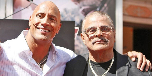 """Dwayne """"The Rock"""" Johnson and his father, Rocky Johnson"""