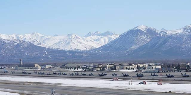24 F-22 Raptors, a C-17 Globemaster III and an E-3 Sentry gathered on theJoint Base Elmendorf-Richardson flight line.