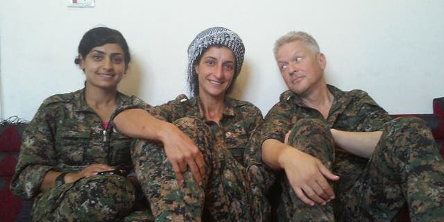 Michael Enright with two YPJ soldiers, both of who have died in the battle fighting ISIS in Syria