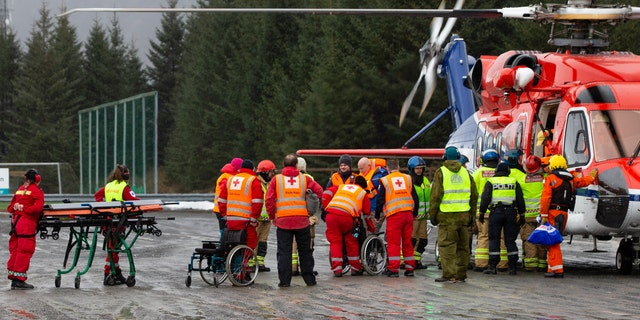 Passengers are helped from a rescue helicopter in Fraena, Norway, on Sunday after being rescued from the Viking Sky cruise ship.