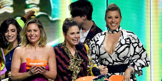 "Candace Cameron-Bure, from left, Andrea Barber and Jodie Sweetin, from the cast of ""Fuller House,"" accept the award for favorite funny TV show at the Nickelodeon Kids' Choice Awards."