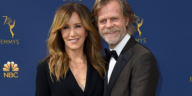 Felicity Huffman, left, and William H. Macy arrive at the 70th Primetime Emmy Awards in Los Angeles.