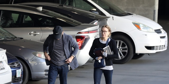 Felicity Huffman and William H.Macy walking behind to a Federal building in Los Angeles on Friday.