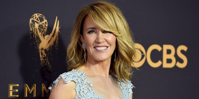 Felicity Huffman was reportedly greeted by FBI agents with their guns drawn Tuesday morning at her Los Angeles home. (Photo by Jordan Strauss/Invision/AP, File)