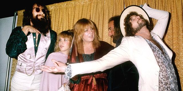 Fleetwood Mac (L-R Mick Fleetwood, Stevie Nicks, Christine McVie, John McVie and Lindsey Buckingham) pose for photographers backstage at the 5th American music Awards held at the Santa Monica Civic Auditorium on January 16, 1978 in Santa Monica, California.