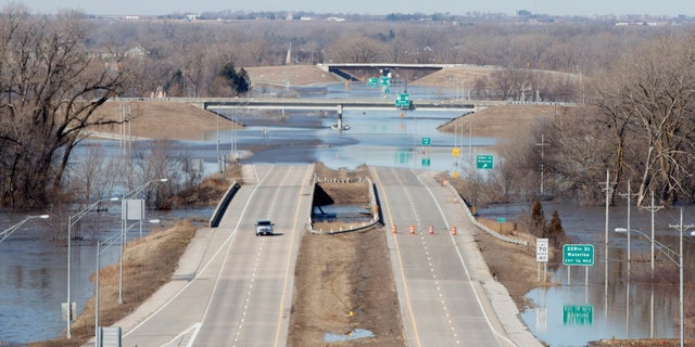 Dodge street is closed from flood waters on Saturday March 16, 2019 in Omaha Neb. (Jeff Bundy/Omaha World-Herald via AP)