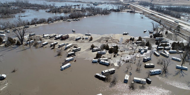 This Wednesday, Mar 20, 2019 aerial print shows flooding nearby a Platte River in in Plattsmouth, Neb., south of Omaha.