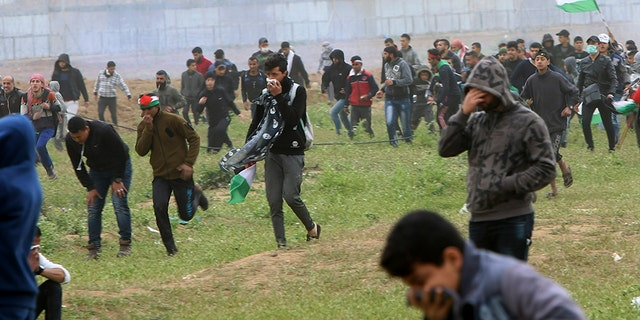 On Saturday, March 30, 2019, protesters will be running tear gas on the first anniversary of Gaza's border demonstrations, fired by Israeli forces near a fence on the border with Israel. Tens of thousands of Palestinians protested.