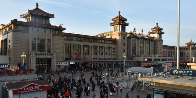 General view of passengers at the Beijing rail station.