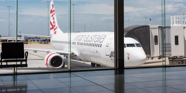 """Virgin Australia later apologized for """"any breakdown in communication"""" between the airline and John's mother."""