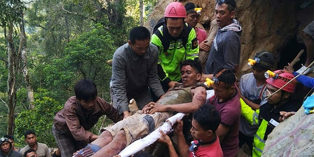 Rescuers evacuate a survivor from inside of the collapsed gold mine.