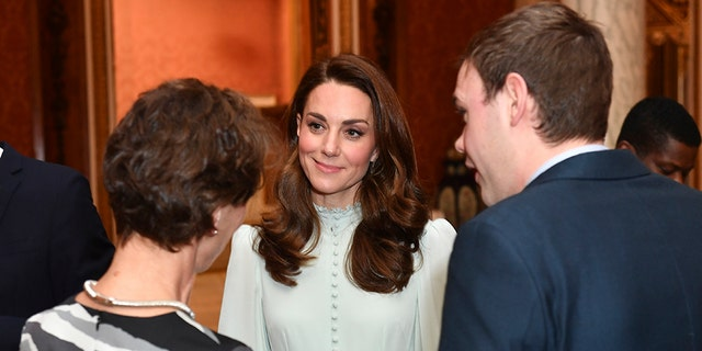 Kate Middleton stunned in a mint-green ruffled dress. (AP)