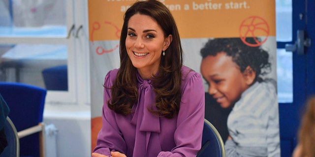 Britain's Kate the Duchess of Cambridge sits, during a visit to the Henry Fawcett Children's Centre in Kennington, London, Tuesday, March 12, 2019.