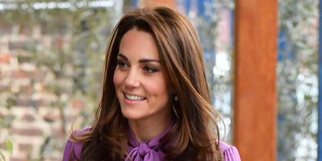 Kate Middleton wore a purple Gucci blouse to the event.