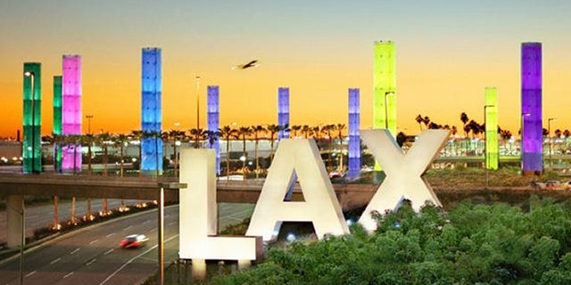 Lightning on Tuesday night caused a power outage at Los Angeles International Airport and forced a plane to return to the airport after being struck by lightning, officials said.