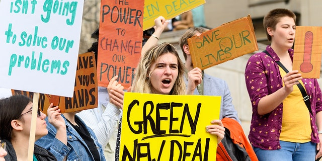 NEW YORK, NY, UNITED STATES - Demonstrators seen holding placards during the Climate Strike at Columbia University in New York City, NY. (Photo by Michael Brochstein/SOPA Images/LightRocket via Getty Images)