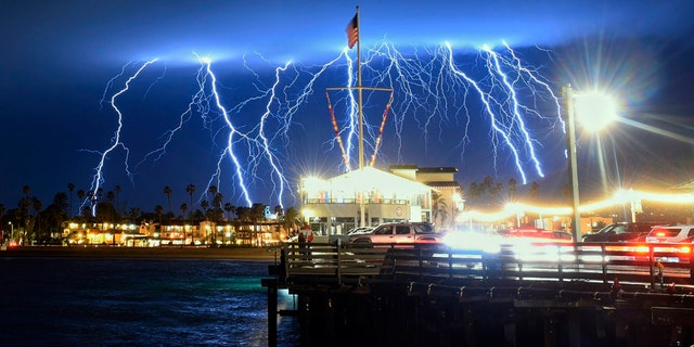 This time exposure photo provided by the Santa Barbara County Fire Department shows a series of lightning strikes over Santa Barbara, Calif., seen from Stearns Wharf in the city's harbor, Tuesday evening, March 5, 2019.