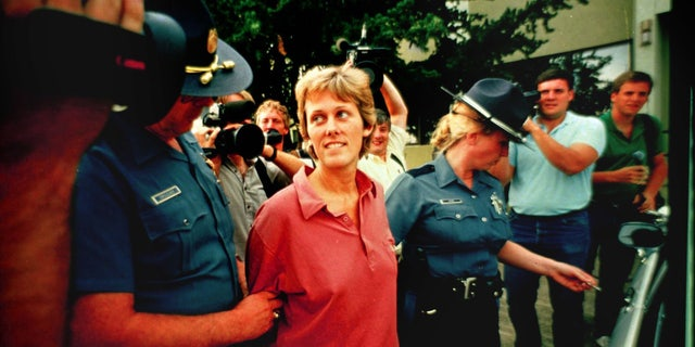Diane Downs is escorted out of state police headquarters in Salem, Ore., on July 21, 1987.