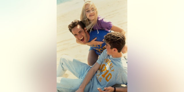 "Luke Perry, Jennie Garth, and Brian Austin Green of ""Beverly Hills, 90210"" in 1991."