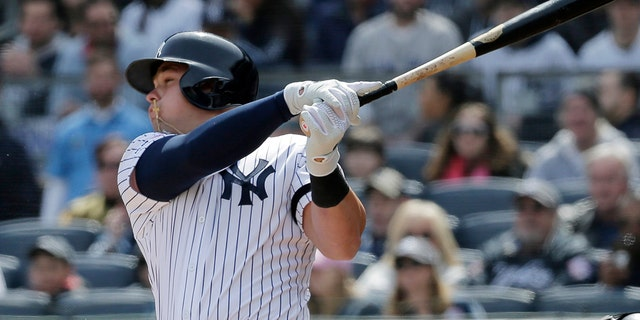 New York Yankees' Luke Voit hits a three-run homer during the first inning of an Opening Day baseball game Thursday against the Baltimore Orioles at Yankee Stadium in New York. (Associated Press)