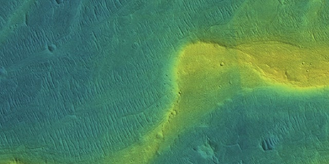 This NASA image shows a preserved river channel on Mars, with color overlaid to indicate elevation (blue is low, yellow is high). The range of elevation in the snapshot is about 115 feet (35 meters).