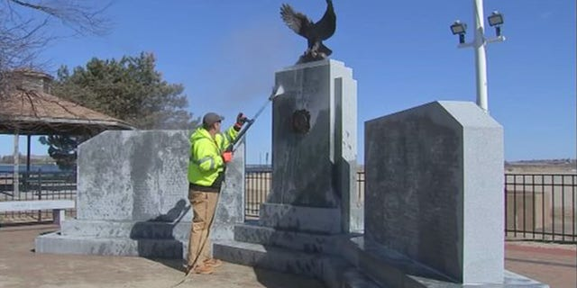 Officials spent Monday trying to clean the oily substance off the monument.
