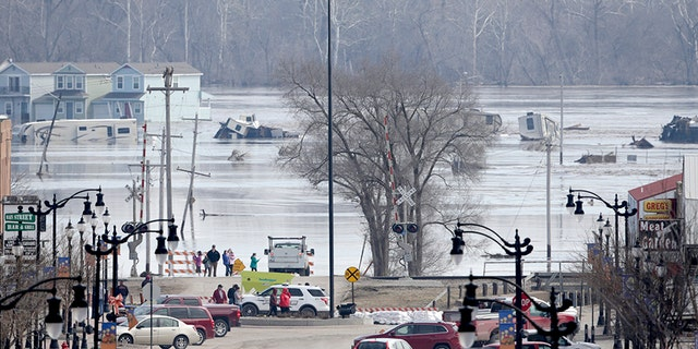 People view the rising waters from the Platte and Missouri rivers which flooded areas of Plattsmouth, Neb., on Sunday.
