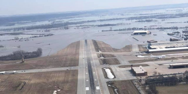 The runway at Offutt Air Force Base can be seen covered by floodwaters from the Missouri River during flooding in 2019.
