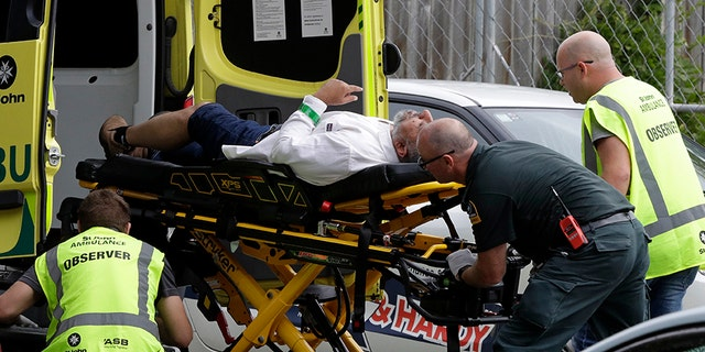 Ambulance staff provides aid to a man following the attacks in Christchurch, New Zealand on Friday. (AP)