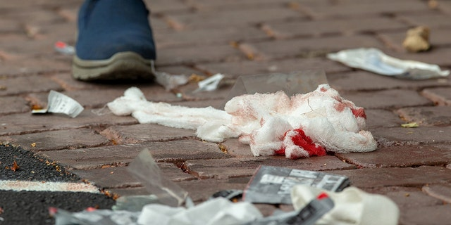Bloodied bandages on the road following a shooting at the Al Noor mosque in Christchurch, New Zealand, March 15, 2019. REUTERS/SNPA/Martin Hunter