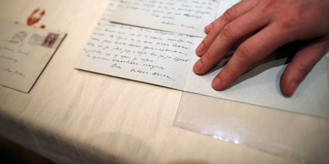 Viktor Lazic from Adligat group displays two letters written by 19th century inventor and electricity pioneer Nikola Tesla in Belgrade, Serbia, Thursday, March 7, 2019. A private culture society in Serbia has made public two letters written by Serb-American inventor and electricity pioneer Nikola Tesla. The Adligat group has told The Associated Press they recently obtained the letters from a collector and verified their authenticity with multiple sources. (AP Photo/Darko Vojinovic)