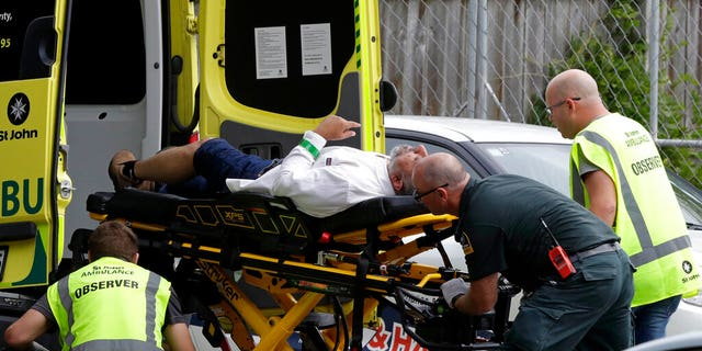 "Ambulance staff take a man from outside a mosque in central Christchurch, New Zealand, Friday, March 15, 2019. Multiple people were killed in mass shootings at two mosques full of worshippers attending Friday prayers on what the prime minister called ""one of New Zealand's darkest days,"" as authorities detained four people and defused explosive devices in what appeared to be a carefully planned attack"