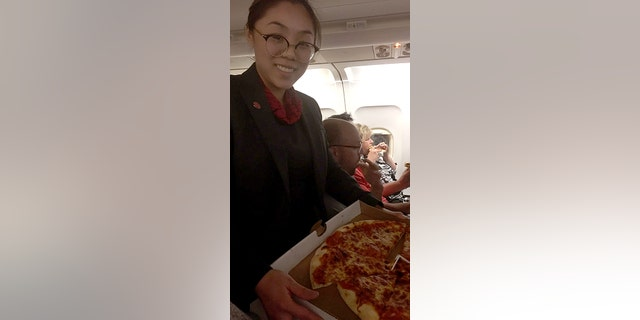 """The Air Canada pilot took a """"stressful"""" situation and made it """"a lot easier,"""" according to one passenger."""
