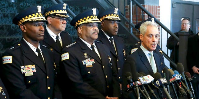 "Chicago Mayor Rahm Emanuel, right, and Chicago Police Superintendent Eddie Johnson, center, at a news conference last month after prosecutors abruptly dropped all charges against ""Empire"" actor Jussie Smollett. (AP Photo/Teresa Crawford, File)"