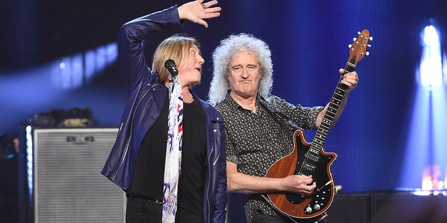 Inductee Joe Elliott, of Def Leppard, left, performs with Brian May, of Queen, at the Rock and Roll Hall of Fame induction ceremony.