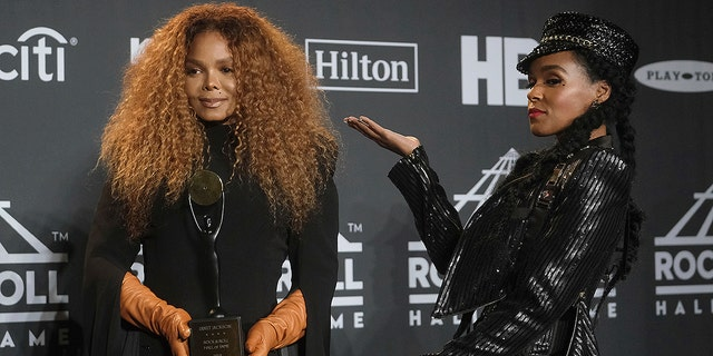 Inductee Janet Jackson, left, holds her trophy as she poses in the press room with Janelle Monae at the Rock & Roll Hall of Fame induction ceremony at the Barclays Center on Friday, March 29, 2019, in New York.