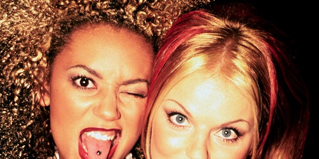 Mel B and Geri Halliwell (Upsetting and Ginger) of the Spice Ladies photographed within the succor of the curtain on the Brit Awards in February 1997.
